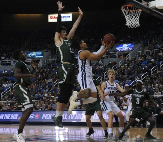 Nevada's Jazz Johnson drives against Colorado State earlier this season. The Wolf Pack and the Rams play Wednesday in Fort Collins.