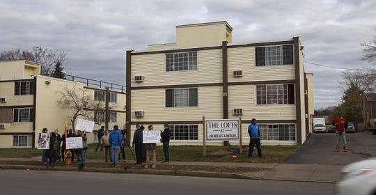 A small but vocal group gather to protest evictions from the Clinton Lofts apartment complex at 1624 N. Clinton Ave., and two other buildings in Rochester Thursday, Jan. 2, 2020.