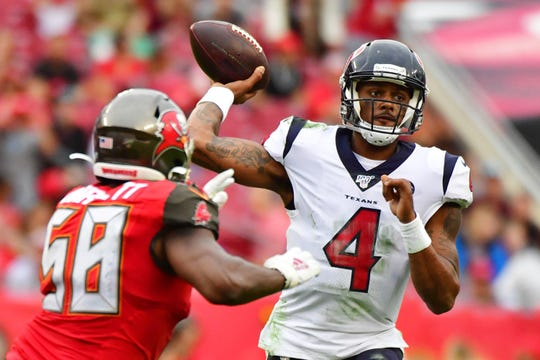 Deshaun Watson of the Houston Texans drops back to throw a pass under pressure from Shaquil Barrett of the Tampa Bay Buccaneers during the fourth quarter of a football game at Raymond James Stadium on December 21, 2019 in Tampa, Florida.
