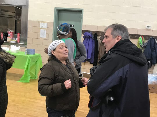 D&C Photographer Shawn Dowd, right, chats with Francia Ortiz during the Danforth Community Center's holiday luncheon on Thursday, Dec. 19, 2019, in Rochester, New York.