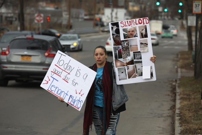 Tenants rights activist Barbara Rivera of Rochester walks along North Clinton Avenue as she draws attention to a protest to stop 55 evictions from the Clinton Lofts apartment complex at 1624 N. Clinton Ave.
