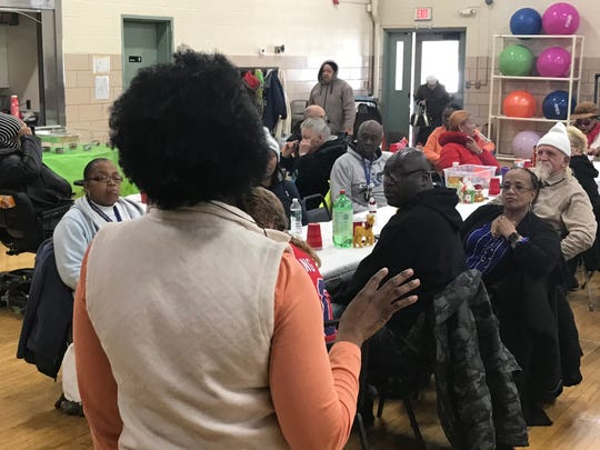 D&C Community Engagement Editor Sheila Rayam speaks to Rochester residents attending the Danforth Community Center's holiday luncheon on Thursday, Dec. 19, 2019. Rayam is leader of the newspaper's mobile newsroom, which operated out of the community center in December and early January.
