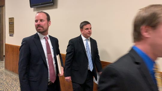 Monroe County Assistant District Attorney Matt Schwartz, left, enters court.