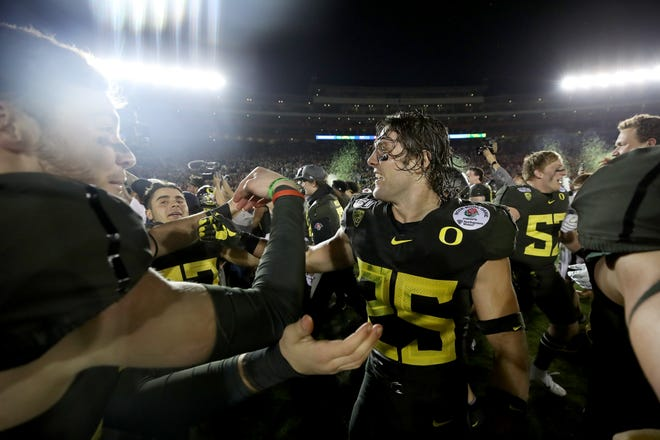 Brady Breeze #25 of the Oregon Ducks celebrates with his teammates after defeating the Wisconsin Badgers in the Rose Bowl game presented by Northwestern Mutual at Rose Bowl on January 01, 2020 in Pasadena, California.