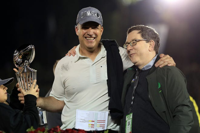 Coach Mario Cristobal and University of Oregon president Michael Schill celebrate the Ducks' win over Wisconsin in the Rose Bowl on Jan. 1, 2020, in Pasadena, California.