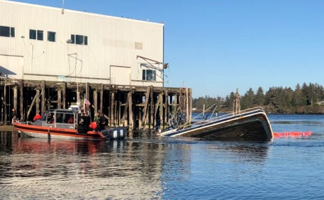 A Coast Guard boat crew assisted four people from a commercial fishing vessel that sank in Coos Bay, Dec. 26, 2019.
