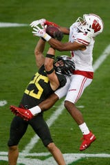 Oregon Ducks safety Brady Breeze (25) breaks up a pass for Wisconsin Badgers wide receiver Kendric Pryor (3) during the second half at the Rose Bowl Stadium.