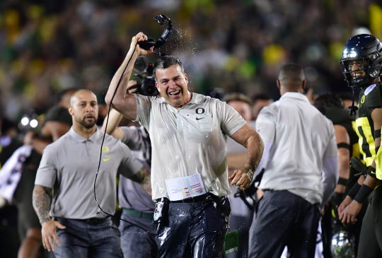 Oregon Ducks head coach Mario Cristobal celebrates after the Oregon Ducks defeated the Wisconsin Badgers during the 106th Rose Bowl game at Rose Bowl Stadium.