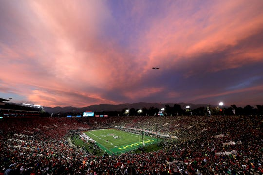 The sun sets as the Oregon Ducks play the Wisconsin Badgers during the third quarter in the Rose Bowl game presented by Northwestern Mutual at Rose Bowl on January 01, 2020 in Pasadena, California.