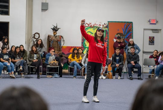 "Samantha Varela puts her fist up after reciting her ""I'm Mexican"" poem during the Brown Issues open mic inside the Alisal Center for the Fine Arts in East Salinas on Dec. 28, 2019."