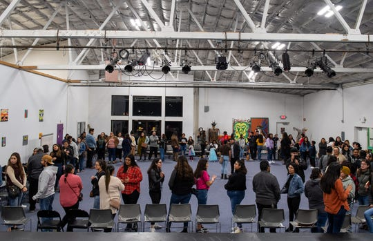 People participate in a giant ice breaker during the Brown Issues pop-up event inside the Alisal Center for the Fine Arts in East Salinas on Dec. 28, 2019.