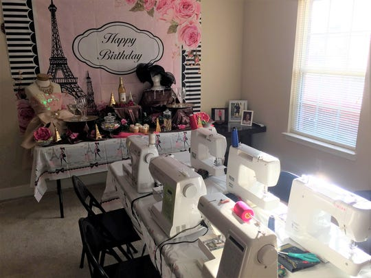 Owner of Sewority House, Uniquka Christian, sets up birthday sewing party.