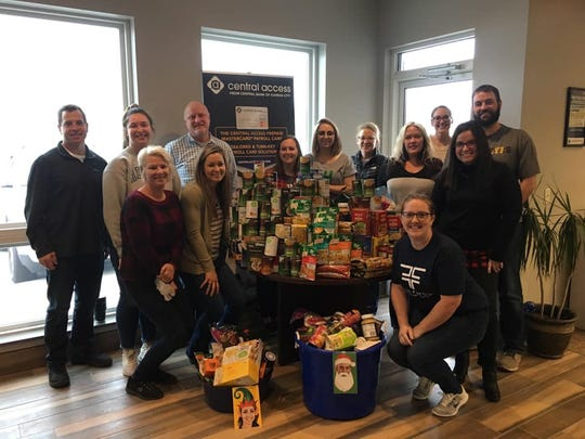 Members from Central Payments in Dell Rapids made the first donation to the Heavenly Helpers on the Highway mobile food pantry.