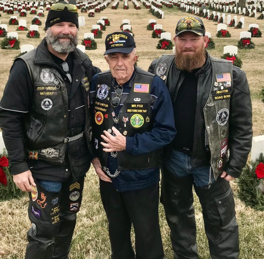 Robert Shawley (left to right), of Clever, and Ed Fox, who was at the WW II battle at Midway, of Springfield, and Kevin Crabb, of Strafford, were part of a team of volunteers who made sure that for the first time all 19,000 veterans at both of Springfield's veterans cemeteries had a holiday wreath placed on their grave.