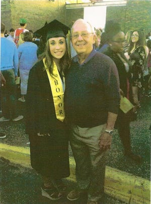 Emma Broos with Bill Drigans at her high school graduation.