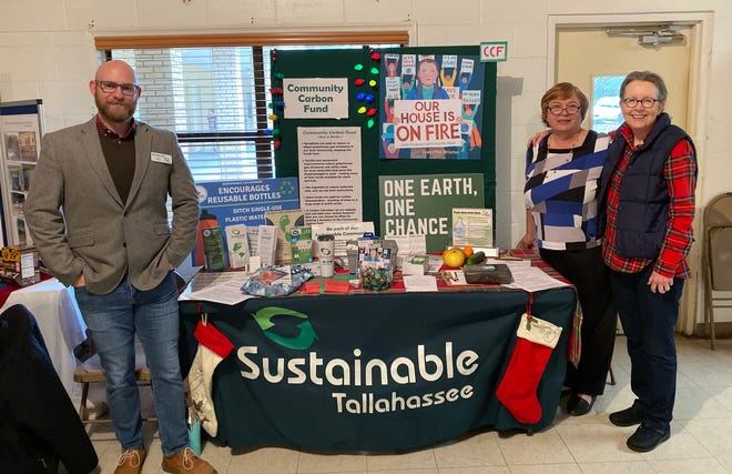 Mike Mitchell, Gail Hankinson and Pam McVetty seeking contributions for the Community Carbon Fund at the Alternative Christmas Market.