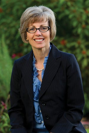 Cathy Adkison, CEO of Big Bend Hospice 2011-2019, loved blue, pearls and inspired hope.