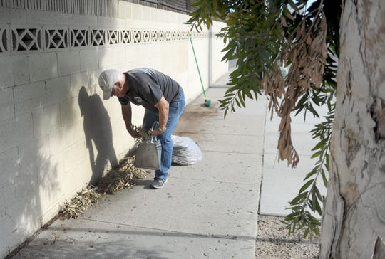 Marvin Boos, 76, cleans the sidewalks of trash along Gonzales and Ventura roads in Oxnard on Jan. 2, 2020. The City Council will honor him next week.