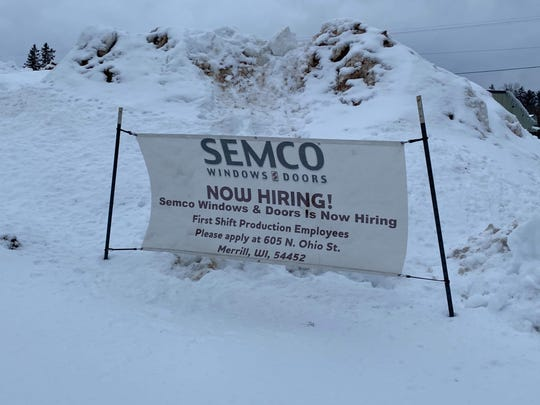 A now hiring sign still fluttered in the wind in front of Semco Windows and doors on Thursday, despite the news that the business closed on Tuesday.