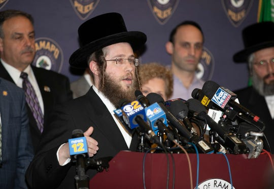 Rabbi Herschel Horowitz, executive director of the Ramapo Community Outreach Center, updates yiddish speaking residents during a press conference at Ramapo Town Hall in Airmont on Thursday, January 2, 2020.