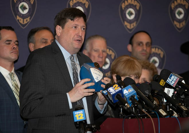 Ramapo supervisor Michael Specht holds a Gabriel smart sensor during a press conference at Ramapo Town Hall in Airmont on Thursday, January 2, 2020.