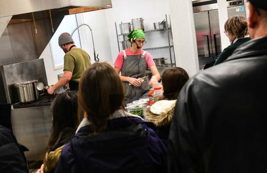 Kate Droske and Tyler Carlson of Early Boots Farm give a demonstration on preparing Pierogies Saturday during the Growers and Makers Marketplace event Saturday, Dec. 14, at Sprout in Little Falls.
