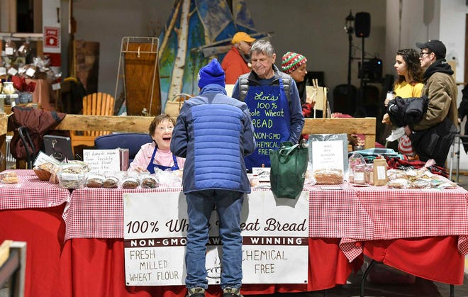 People shop for a wide variety of locally-made and grown items during the Growers and Makers Marketplace event Saturday, Dec. 14, at Sprout in Little Falls.