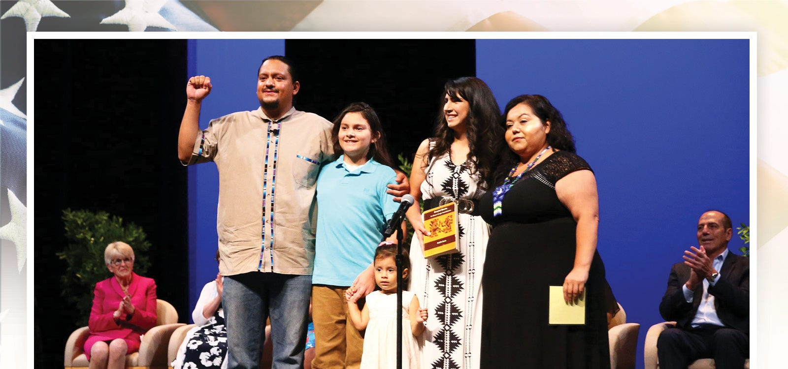 New City of Phoenix councilman for District 8, Carlos Garcia, poses with his family after taking the oath of office during the inauguration ceremony on June 6, 2019, at the Orpheum Theatre in Phoenix, Arizona.