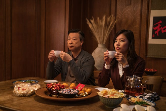 """Years after leaving love behind in his homeland to go to America, an aging Taiwanese man (Tzi Ma, left) needs to come to grips with past decisions to connect with his daughter (Christine Ko) in Netflix's """"Tigertail."""""""
