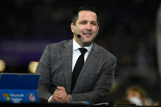 ESPN Monday Night Countdown personality Adam Schefter joins the set before the December 23 Minnesota Vikings - Green Bay Packers game in Minneapolis.