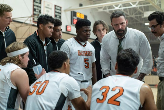 "Ben Affleck (right) stars as a former basketball star who's lost his wife and family due to his addiction but finds redemption coaching his alma mater's high school hoops team in ""The Way Back."""