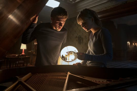 "Connor Jessup as Tyler and Emilia Jones as Kinsey in Netflix's ""Locke & Key."""