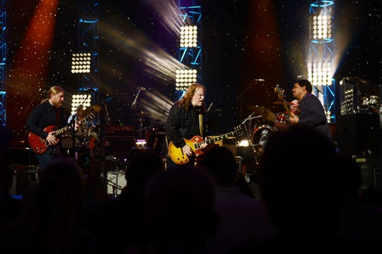 Derek Trucks, from left, Warren Haynes, and Oteil Burbridge performs during All My Friends: Celebrating the Songs & Voice of Gregg Allman at The Fox Theatre on January 10, 2014 in Atlanta, Georgia.
