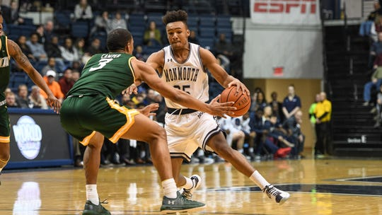 Monmouth point guard Samuel Chaput works agaisnt Siena's Manny Camper during a game last season at OceanFirst Bank Center in West Long Branch.