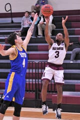 McMurry's Dedrick Berry (3) takes a 3-pointer over LeTourneau's Andrew Eberhardt (4) at Kimbrell Arena on Thursday. Berry knocked down three 3-pointers.