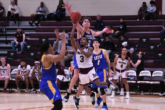 McMurry's Dedrick Berry (3) takes a shot under LeTourneau's John Argue (12) and over Kyle Matthews (5) at Kimbrell Arena on Thursday.