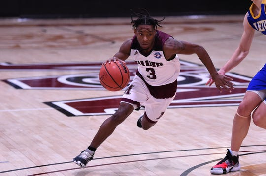 McMurry's Dedrick Berry (3) drives into the lane against LeTourneau at Kimbrell Arena on Thursday. Berry scored a career-high 26 points on his birthday as the War Hawks won 91-86.