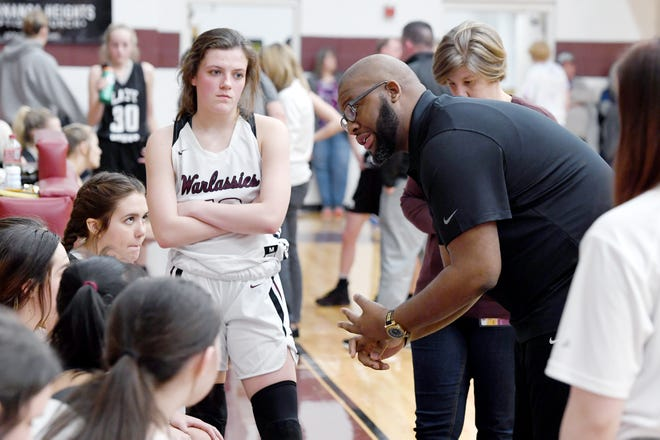 Owen girls basketball coach Anderson Bynum talks with his team during their game against North Buncombe at Owen High School on Jan. 2, 2020.