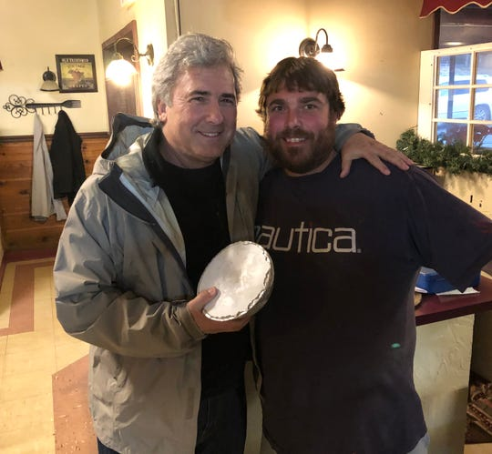 Rob Cuevas, left, stopped by Iannucci's on Jan. 2 to pick up some frozen baked ziti from owner Nick Iannucci. The restaurant closed for good Dec. 31.