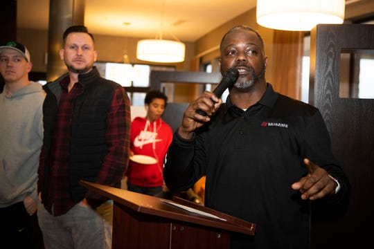 Glenn Hicks, founder of the Musashi Elite basketball league, introduces coaches during their jersey giveaway on Friday, Jan. 3, 2019 at Courtyard by Marriott in Battle Creek, Mich.