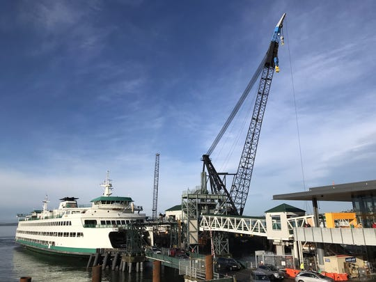 The ferry Tacoma docks at Colman Dock on Friday, Jan. 3, as construction rolls along.