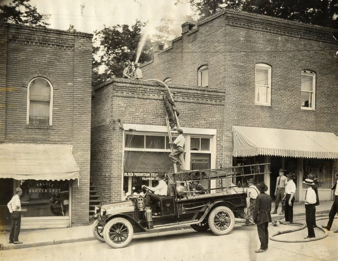 The Black Mountain Fire Department battles a fire on Cherry Street in 1923.