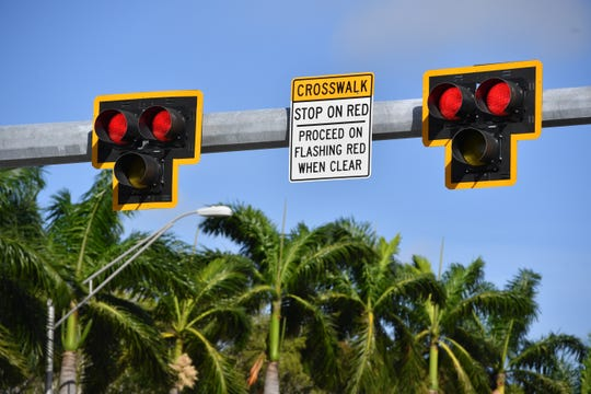 A pedestrian-activated red-light HAWK crosswalk signal at U.S. 41 and First Street in Sarasota.
