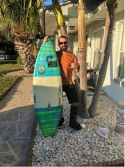 Corey Huau, 41, Satellite Beach, found out the hard way that he's no longer a surfing youngster.