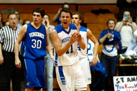 Missisquoi's Matt St. Amour celebrates his 2000th career point as the gym erupts in a game during the 2012-13 season.