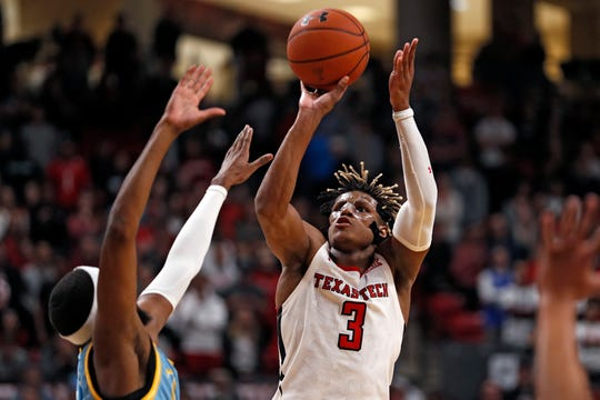 Texas Tech's Jahmi'us Ramsey (3) shoots the ball over Long Island's Ashtyn Bradley (30) down the court during the second half of an NCAA college basketball game Sunday, Nov. 24, 2019, in Lubbock, Texas. (AP Photo/Brad Tollefson)