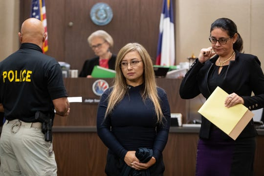 Former Corpus Christi police officer Norma Deleon, who was found guilty in November of two counts of official oppression, appears in the 117th District Court on Friday, Jan. 3, 2019. Her lawyer told the court she may appeal conviction.