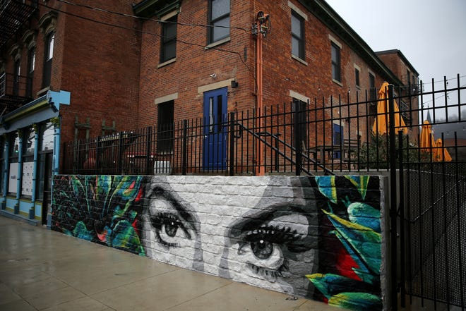 A mural of 1950s Mexican actress Maria Felix's eyes is featured outside, pictured, Friday, Jan. 3, 2020, at La Ofrenda bar in Cincinnati's Over-the-Rhine neighborhood.