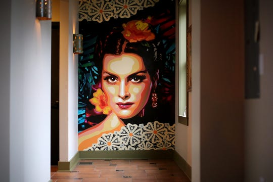 A mural of 1950s Mexican actress Maria Felix, by artist Jenni Ustick, is featured, said owner Jacob Trevino, pictured, Friday, Jan. 3, 2020, at La Ofrenda bar in Cincinnati's Over-the-Rhine neighborhood.