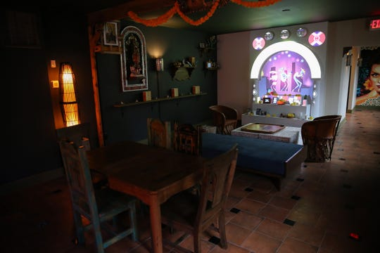 The main space is designed to give a homey feel, much like a living room, pictured, Friday, Jan. 3, 2020, at La Ofrenda bar in Cincinnati's Over-the-Rhine neighborhood. The lighting is intentionally dim, said owner Jacob Trevino.